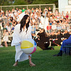 A Dracut High School graduating senior prepares to throw a beach ball into the crowd at Friday's commencement. Lowell Sun/Chris Lisinski