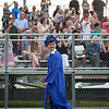 Members of Dracut High School's Class of 2018 enter the football field while families and friends cheer during Friday's graduation. Lowell Sun/Chris Lisinski