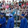 Dracut High School graduating seniors wave to families and friends at Friday's commencement. Lowell Sun/Chris Lisinski