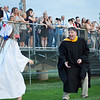 Members of the Class of 2018 celebrate with teachers at Dracut High School's commencement Friday. Lowell Sun/Chris Lisinski