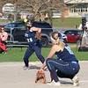 Dracut High School player Kayla Tyler picks up a ground ball and gets ready to throw to first to get the Central Catholic High School Player out. SUN/JOHN LOVE