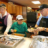 Getting the meals ready for the Meals on Wheels program is from left is volunteers Ethel Morasse and Dianne Vandal with John Jeray the site aid for the Meals on Wheels program for Dracut. SUN/JOHN LOVE