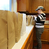 Getting bags of food ready to go out with the Meals on Wheels program is volunteer Rhonda Gray. SUN/JOHN LOVE