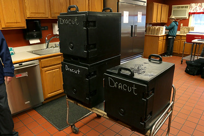 Three of the insulated food transports used by the dracut Council on Aging on Monday morning. SUN/JOHN LOVE