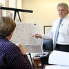 Dracut Town Manager Jim Duggan in his office on Friday morning, April 28, 2017, talking about business expansion and economic development in the town with conservation and recreation Director Lori Cahill, pictured, and town engineer Mark Hamel. SUN/JOHN LOVE