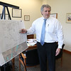 Dracut Town Manager Jim Duggan in his office on Friday morning, April 28, 2017, talking about business expansion and economic development in the town with conservation and recreation Director Lori Cahill and town engineer Mark Hamel. SUN/JOHN LOVE