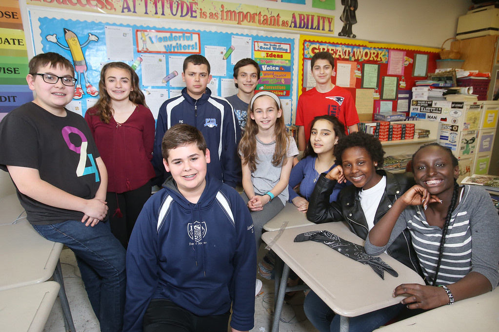 . Richardson Middle School\'s Knowledge Bowl team, clockwise from front: Cooper Levasseur, Matthew Jarek, Marissa Jones, Victor Sousa, Dominic Letizia, Jada Santos, Phillip Conlon, Amelia Whelan, Ivy Ngugi, and Monique Githinji. (SUN/Julia Malakie)