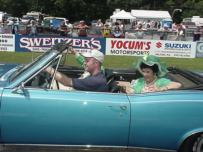 "Mr. and Mrs. Bud Faubel get their ride down the 1320 after the presentation. Beaver Bob reminded the fans that not only was Bud a highly successful and popular drag racer with his series of ""Honker"" cars, he was a decorated jet fighter pilot during the Korean War, as well."