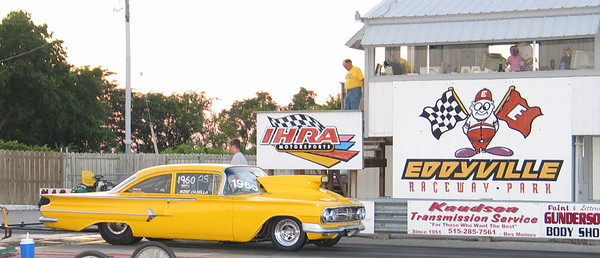 Mike Casella Jr. gets the big Chevy ready to fire up in front of the Eddyville tower. Note that the Eddyville staff also donned Draglist.com Super Crew t-shirts for the event!
