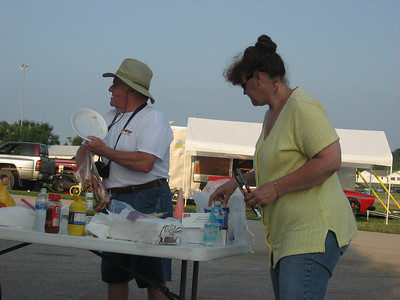 Al Booton and Cheryl Minton prepping the hot dogs.