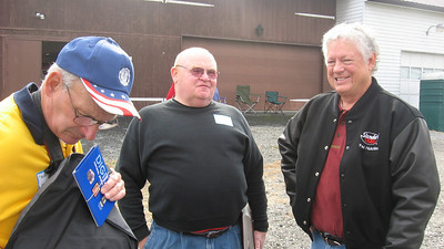 Photographers Mashie Mihalko and Paul Hutchins flank nostalgia top fuel owner (under construction) Brian Beattie.