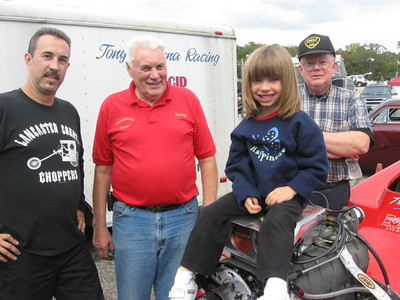 Three generations of hard racing Halls: Mike, legendary Harry Hall, adorable Tori, and Uncle Kevin.