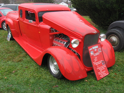 Slammed '34 Dodge pickup featured massive hemi,subtle flames, and unique modern tailgate.