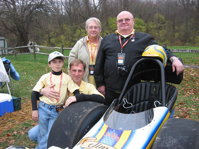 Three generations of Beatties pose with the immaculate new Great Expectations fuel dragster. Left to right, Robbie Beattle, dad Rob Beattie, and grandparents Lois and Brian Beattie, the proud owners.