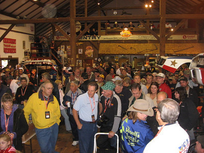 Race and rod fans enjoy the awards presentation and the annual door prize giveaway. Dozens and dozens of door prizes were passed out to the lucky.