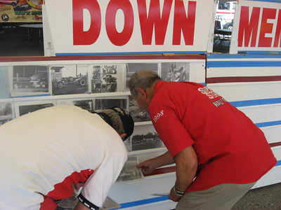 Jack Redd and Julio Mara set up photos for display at the Down Memory Lane section.