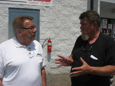 Sam Auxier, Jr., and Doug Rice discuss the finer points of nostalgia drag racing.