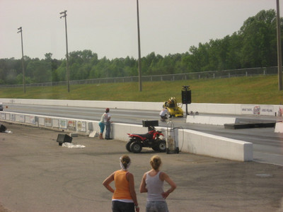Hard to see, but that's Daryl Arnold's wheelstanding golf cart making its way down the track in the right lane.