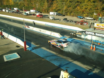 Jake Crimmins and Phil Burkart, Jr., burn out side by side in their second match of day. Crimmins broke moments later and Burkart, Jr., ran a great 6.01, 242 in the Nitro Nick car.