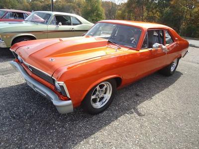 Wicked burnt orange Chevy Nova.