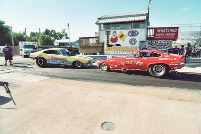 The attendees of the 5th annual Draglist.com Nationals in front of Danny Miller's Randy Baker-driven Rear Gears Nitro AA/Funny Car nose to nose with Vic Miller's Veney's Vega Injected Funny Car.