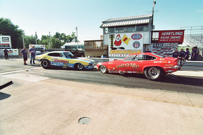 Danny Miller's Randy Baker-driven Rear Gears Nitro AA/Funny Car nose to nose with Vic Miller's Veney's Vega Injected Funny Car.