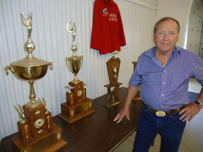 Chuck Hamann was on hand with many of his trophies from highly successful racing efforts in the NHRA in the early 60s. Chuck won the WyoNebCo Dragrace Championship in 1961 and won the West Central Division NHRA Competition Division in 1962 and 1963. This was when there were only two Divisions, Competion and Stock. Chuck competed against every class of competition car from AA/FD to Modied Production and everything in between. In 1962 he entered the U.S. Nationals at Indy. Against a 32 car field, Chuck made it to the final run, He had the race covered, but blew high gear and lost. The old Buick powered Roadster still was the fastest car there and won the Autolite Award for National Top Speed Champion. Chuck says he was just a low buck racer with a homebuilt car. There never was much in the speed equipment fieid for Buick straight eights, so he had to build everything from junkyard parts. It took Chuck several years of work and investment to get the car to that state in 1962. He had a total investment of $600.00 in the car and trailer! The car set strip records every place it ran.