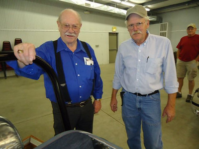 Darrell Zimmerman and Jim Ziegler checking out Jim's boss roadster.