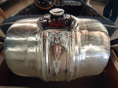 Amazing hand-hammered fuel tank and kool pin striping!