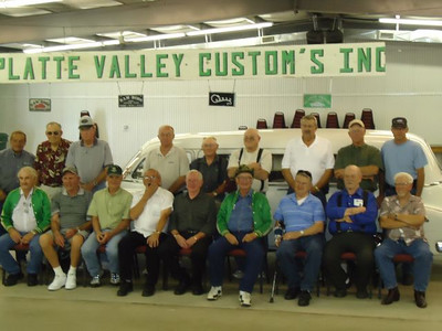Group photo of many of the remaining Platte Valley Customs Club members at the 2010 Julesburg Drag Strip Reunion. Front row: Larry Walters, Butch Walline, Larry Renquist, Kenny Arnold, Don Phelin, Raymond Burgess, Don Fender, Darrell Zimmerman, and Les Copass. Back row: Larry Hansen, Gerald Gerke, Gerald Kalb, Butch Stone, Steve Schwartz, Vaughn Hartwell, Marvin Nelson, Wayne Thelander, Craig Leef.