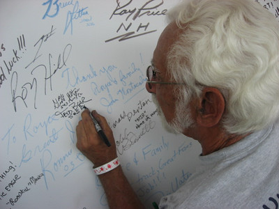 Fred Bear adds his name to the MIR Announcer Booth Wall of Fame.
