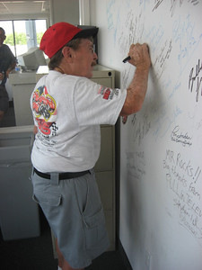 Gene Altizer signs the MIR Announcer's Booth Wall of Fame.