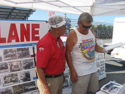 Legendary promoter Julio Marra is still going strong at 80. Here he helps a car guy find the photo he wants.
