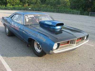 Small block Cuda valiantly fought the big block cars in the powerstand contest.