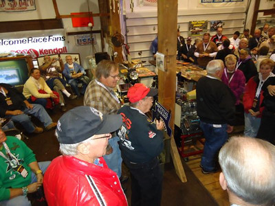 Gene Altizer says a few words after the S&S Racing Team was awarded the USA-1 Nostalgia Drag Racing Enthusiast award as Bruce Larson, Dave Heisey, and Dick Gerwer look on.