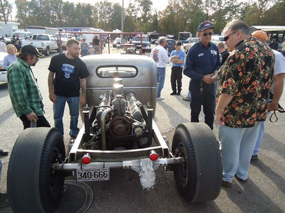 Tim Pratt (right) and other guys are intrigued by the amazing 12 cylinder custom truck.