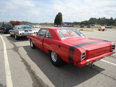 Dodge Dart follows big Chevy Chevelle to the line. Great looking American iron filled the pits all week.