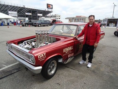 Steve Motts is rightfully proud owner with his mighty '64 Dodge.