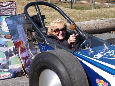 Ed Kowalski's widow brought his injected small block Chevy dragster to the 2013 Eastern Museum of Motor Racing Open House on April 6, 2013. She sits in as the car is fired up.