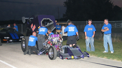 Killer night shot of Nitro Madness in the staging lanes as the Spear Boys look on.