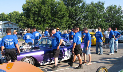 More blue shirts as the Draglist Super Crew surrounds Rapid Randy's awesome 'Vette.