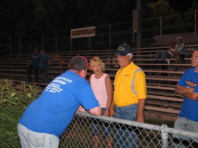 Lippy proudly displays his Mike Casella Racing team shirt in a conversation with Jer. Georgeous Trish Lippoldt and Brandon Chandler look on...
