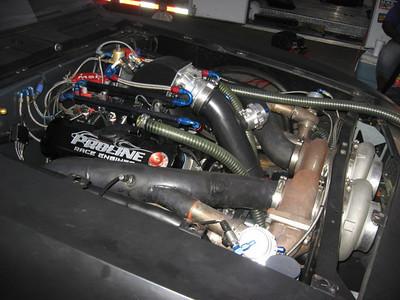 Massive twin turbo motor stuffed into a 67 Camaro.