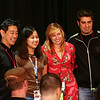 Grant Imahara, a fan, Kari Byron, and  Tory Bellici are members of the Mythbuster build team