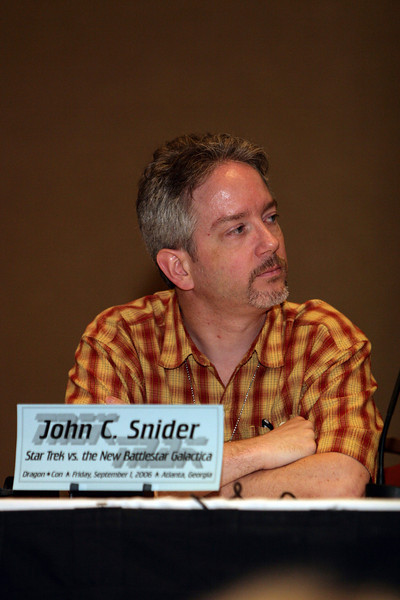 "John C. Snider is the editor of the online science fiction magazine <a href=""http://www.scifidimensions.com"">http://www.scifidimensions.com</a>"