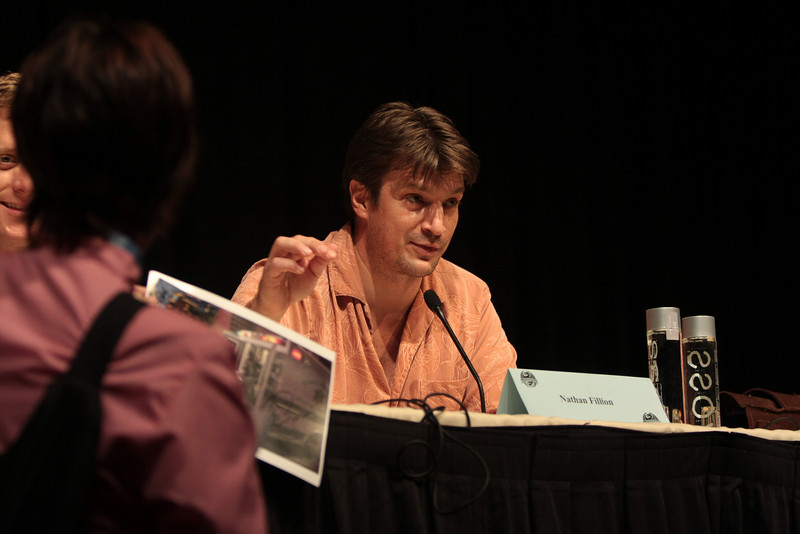 Nathan Fillion and Alan Tudyk of Firefly and Serenity giving gifts to the fans that asked questions during the Q&A