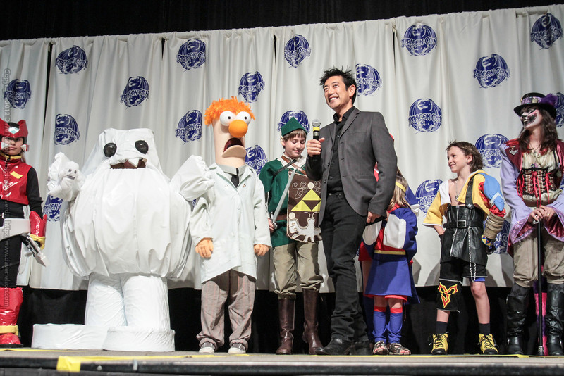 Grant Imahara interviews the youth costume contestants at the Masquerade Costume Contest
