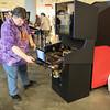 Brain working on an arcade machine at DragonCon 2016