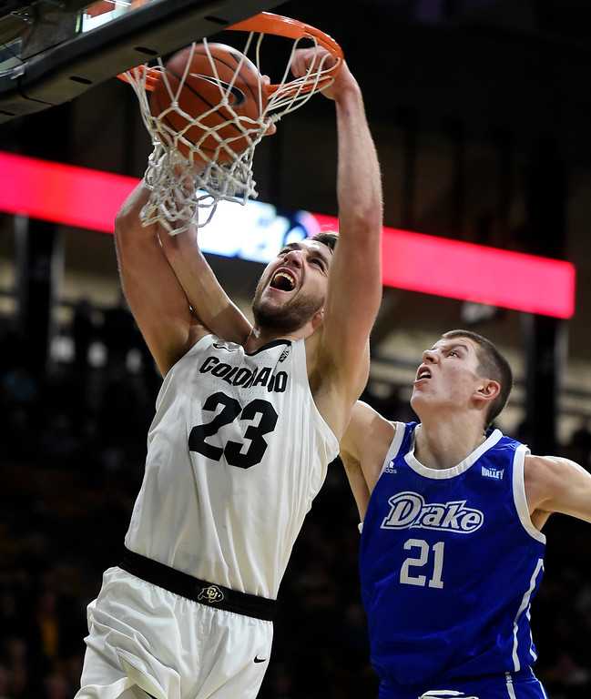 . BOULDER, CO: November 13: University of Colorado\'s  Lucas Siewert, left, gets a dunk past Drake\'s Liam Robbins during the game with the Drake Bulldogs. (Photo by Cliff Grassmick/Staff Photographer)