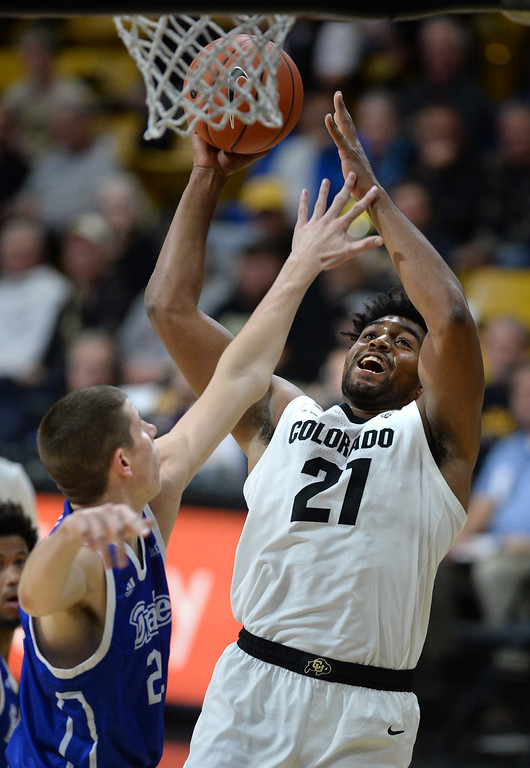 . BOULDER, CO: November 13: Colorado\'s Evan Battey drives to the basket on Drake\'s Liam Robbins during the game with the Drake Bulldogs. (Photo by Cliff Grassmick/Staff Photographer)